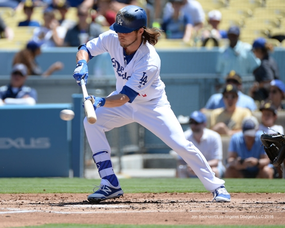 Josh Reddick bunts during game against the Pittsburgh Pirates Saturday, August 13, 2016 at Dodger Stadium in Los Angeles,California. Photo by Jon SooHoo/©Los Angeles Dodgers,LLC