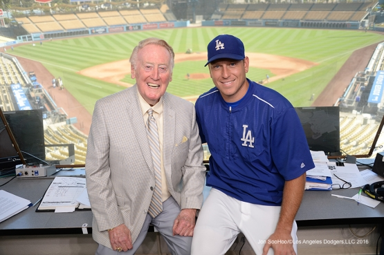 A.J.Ellis visits Vin Scully prior to game against the Pittsburgh Pirates Sunday, August 14, 2016 at Dodger Stadium in Los Angeles,California. Photo by Jon SooHoo/©Los Angeles Dodgers,LLC 2016