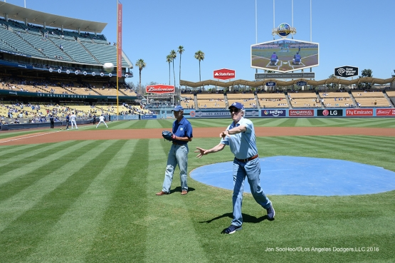 Stephen Bochco and Dr. Stephen Forman throw out the first pitch prior to game against the Pittsburgh Pirates Sunday, August 14, 2016 at Dodger Stadium in Los Angeles,California. Photo by Jon SooHoo/©Los Angeles Dodgers,LLC 2016