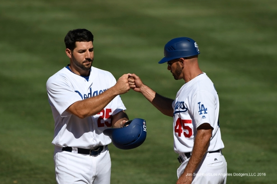 Rob Segedin and Chris Woodward during game against the Pittsburgh Pirates Sunday, August 14, 2016 at Dodger Stadium in Los Angeles,California. Photo by Jon SooHoo/©Los Angeles Dodgers,LLC 2016