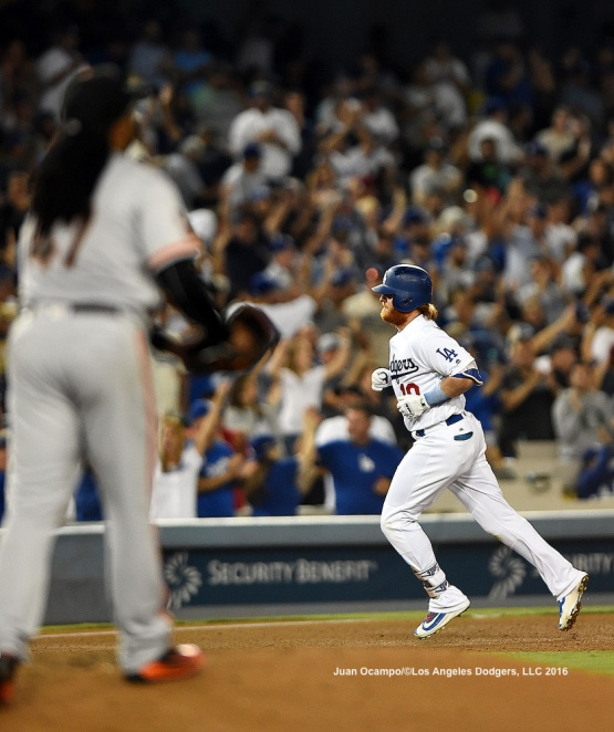Justin Turner rounds the bases after his fourth inning home run off of the Giants' Johnny Cueto. The Dodgers beat the Giants, 1-0.