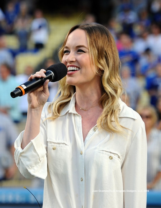 Actress Kelly Jakle performs the national anthem. Jakle is also the great granddaughter of Branch Rickey.