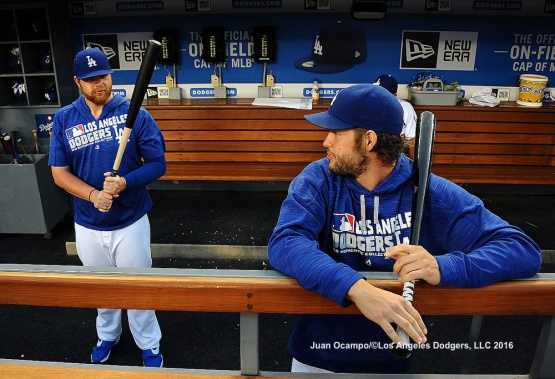 Brett Anderson and Clayton Kershaw loosen up in the dugout.