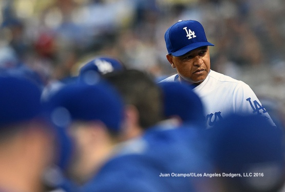 Dodgers manager Dave Roberts thinks about reviewing a play at first base.