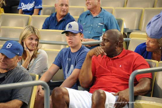 "Earvin ""Magic"" Johnson with the Boehly family  during game against the San Francisco Giants Thursday, August 25, 2016 at Dodger Stadium in Los Angeles,California. Photo by Jon SooHoo/©Los Angeles Dodgers,LLC 2016"