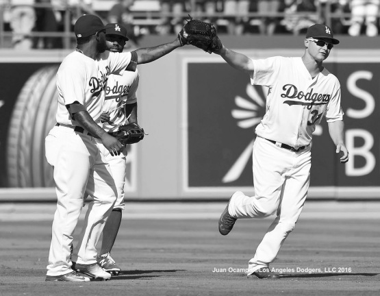 Howie Kendrick, Andrew Toles and Joc Pederson celebrate the Dodgers' 1-0 win against the Cubs. LOS ANGELES - AUGUST 23:  San Francisco Giants against the Los Angeles Dodgers on August 24, 2016 at Dodger Stadium in Los Angeles, California. LOS ANGELES - AUGUST 23:  San Francisco Giants against the Los Angeles Dodgers on August 24, 2016 at Dodger Stadium in Los Angeles, California. LOS ANGELES - AUGUST 23:  San Francisco Giants against the Los Angeles Dodgers on August 24, 2016 at Dodger Stadium in Los Angeles, California. LOS ANGELES - AUGUST 23:  San Francisco Giants against the Los Angeles Dodgers on August 24, 2016 at Dodger Stadium in Los Angeles, California. LOS ANGELES - AUGUST 23:  San Francisco Giants against the Los Angeles Dodgers on August 24, 2016 at Dodger Stadium in Los Angeles, California. LOS ANGELES - AUGUST 24:  San Francisco Giants against the Los Angeles Dodgers on August 24, 2016 at Dodger Stadium in Los Angeles, California. LOS ANGELES - AUGUST 24:  San Francisco Giants against the Los Angeles Dodgers on August 24, 2016 at Dodger Stadium in Los Angeles, California. LOS ANGELES - AUGUST 23:  San Francisco Giants against the Los Angeles Dodgers on August 24, 2016 at Dodger Stadium in Los Angeles, California. LOS ANGELES - AUGUST 23:  San Francisco Giants against the Los Angeles Dodgers on August 24, 2016 at Dodger Stadium in Los Angeles, California. LOS ANGELES - AUGUST 23:  San Francisco Giants against the Los Angeles Dodgers on August 24, 2016 at Dodger Stadium in Los Angeles, California. LOS ANGELES - AUGUST 23:  San Francisco Giants against the Los Angeles Dodgers on August 24, 2016 at Dodger Stadium in Los Angeles, California. LOS ANGELES - AUGUST 24:  San
