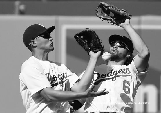 Corey Seager and Charlie Culberson chase down the pop fly in the eighth inning. LOS ANGELES - AUGUST 23:  San Francisco Giants against the Los Angeles Dodgers on August 24, 2016 at Dodger Stadium in Los Angeles, California. LOS ANGELES - AUGUST 23:  San Francisco Giants against the Los Angeles Dodgers on August 24, 2016 at Dodger Stadium in Los Angeles, California. LOS ANGELES - AUGUST 23:  San Francisco Giants against the Los Angeles Dodgers on August 24, 2016 at Dodger Stadium in Los Angeles, California. LOS ANGELES - AUGUST 23:  San Francisco Giants against the Los Angeles Dodgers on August 24, 2016 at Dodger Stadium in Los Angeles, California. LOS ANGELES - AUGUST 23:  San Francisco Giants against the Los Angeles Dodgers on August 24, 2016 at Dodger Stadium in Los Angeles, California. LOS ANGELES - AUGUST 24:  San Francisco Giants against the Los Angeles Dodgers on August 24, 2016 at Dodger Stadium in Los Angeles, California. LOS ANGELES - AUGUST 24:  San Francisco Giants against the Los Angeles Dodgers on August 24, 2016 at Dodger Stadium in Los Angeles, California. LOS ANGELES - AUGUST 23:  San Francisco Giants against the Los Angeles Dodgers on August 24, 2016 at Dodger Stadium in Los Angeles, California. LOS ANGELES - AUGUST 23:  San Francisco Giants against the Los Angeles Dodgers on August 24, 2016 at Dodger Stadium in Los Angeles, California. LOS ANGELES - AUGUST 23:  San Francisco Giants against the Los Angeles Dodgers on August 24, 2016 at Dodger Stadium in Los Angeles, California. LOS ANGELES - AUGUST 23:  San Francisco Giants against the Los Angeles Dodgers on August 24, 2016 at Dodger Stadium in Los Angeles, California. LOS ANGELES - AUGUST 24:  San Francisco Gian