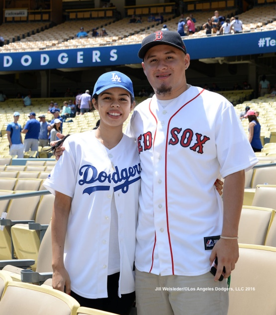 A Dodger and Red Sox couple pose for a photo prior to the start of the game. Jill Weisleder/Dodgers