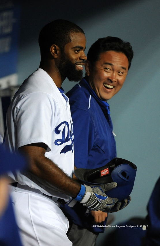 "Dodgers massage therapist Yosuke ""Possum"" Nakajima and Andrew Toles smile in the dugout after Toles drives in three runs during the game against the Giants. Jill Weisleder/Dodgers"