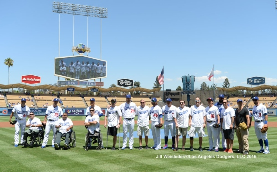 The Dodgers host the SoldierCare Project as a group of heroes pose for a photo after throwing the ceremonial first pitch prior to the start of the game. Jill Weisleder/Dodgers