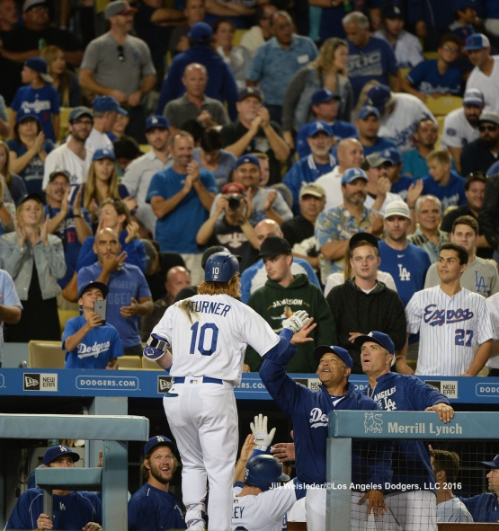 Justin Turner is greeted with high-fives as he comes in to score. Jill Weisleder/Dodgers