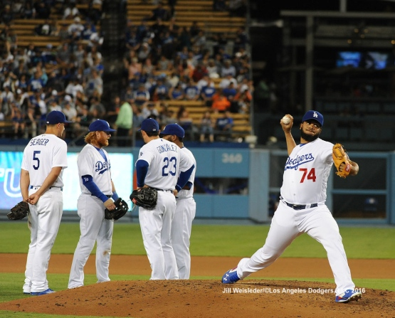 The team looks on as Kenley Jansen warms up on the mound in the eighth inning. Jill Weisleder/Dodgers