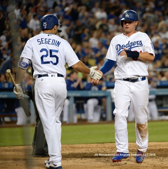 Joc Pederson scores in a run on Howie Kendrick's double in the fifth inning. Jill Weisleder/Dodgers