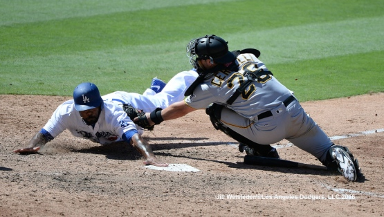 Howie Kendrick slides safely under the glove of Pirates catcher Francisco Cervelli. Jill Weisleder/Dodgers