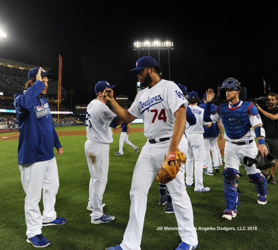 Clayton Kershaw congratulates Kenley Jansen after recording his 36th save of the season. Jill Weisleder/Dodgers