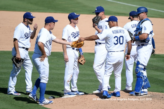 Dodger skipper Dave Roberts gives the ball to Joe Blanton in the sixth inning. Jill Weisleder/Dodgers