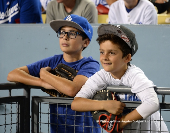 Young Dodger fans wait patiently hoping to getting a ball. Jill Weisleder/Dodgers