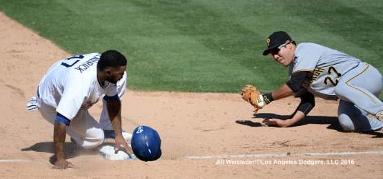Howie Kendrick looks at Pirates Jung Ho Kang as he is called safe at third base. Jill Weisleder/Dodgers