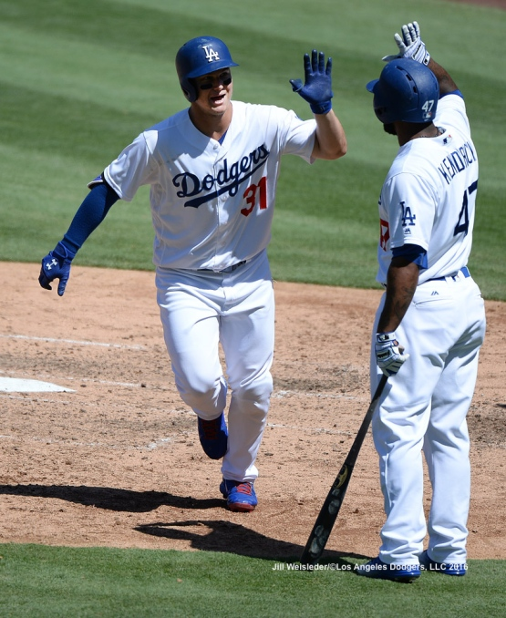 Howie Kendrick high-fives Joc Pederson as he comes in to score. Jill Weisleder/Dodgers