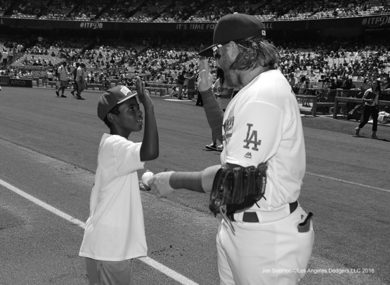Justin Turner and young fan prior to  game against the Chicago Cubs Sunday, August 28, 2016 at Dodger Stadium in Los Angeles,California. Photo by Jon SooHoo/©Los Angeles Dodgers,LLC 2016