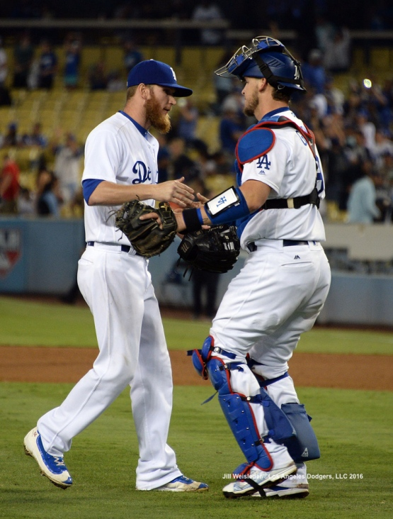 J.P. Howell and Yasmani Grandal congratulate each other after the Dodgers beat the Philadelphia Phillies 9-3. Jill Weisleder/Dodgers