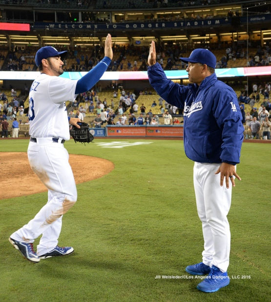Adrian Gonzalez and Dave Roberts high-five each other after the win. Jill Weisleder/Dodgers