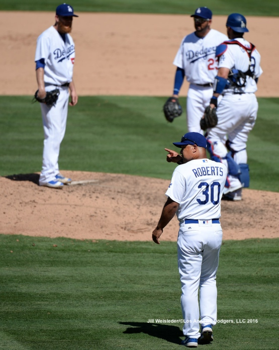 Dodger manager Dave Roberts points to the bullpen after pulling J.P. Howell from the mound. Jill Weisleder/Dodgers