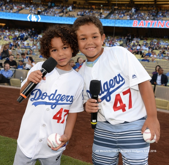 "Dodger left-fielder Howie Kendrick's kids get ready to say ""It's Time for Dodger Baseball"" prior to the start of the game. Jill Weisleder/Dodgers"
