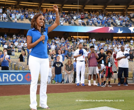 Actress Holly Robinson Peete performs the national anthem as her family watches from the side. Jill Weisleder/Dodgers