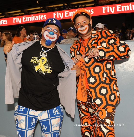Dodgers and Giants fans show their support for their respective teams. Jill Weisleder/Dodgers