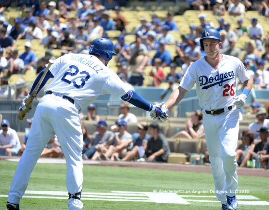 Adrian Gonzalez high-fives Chase Utley as he comes in to score. Jill Weisleder/Dodgers