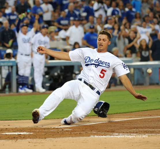 Corey Seager slides home safely to score in a run in the first inning. Jill Weisleder/Dodgers