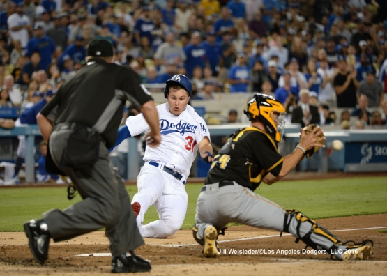 Joc Pederson slides safely under the glove of Pittsburgh Pirates catcher Eric Fryer. Jill Weisleder/Dodgers