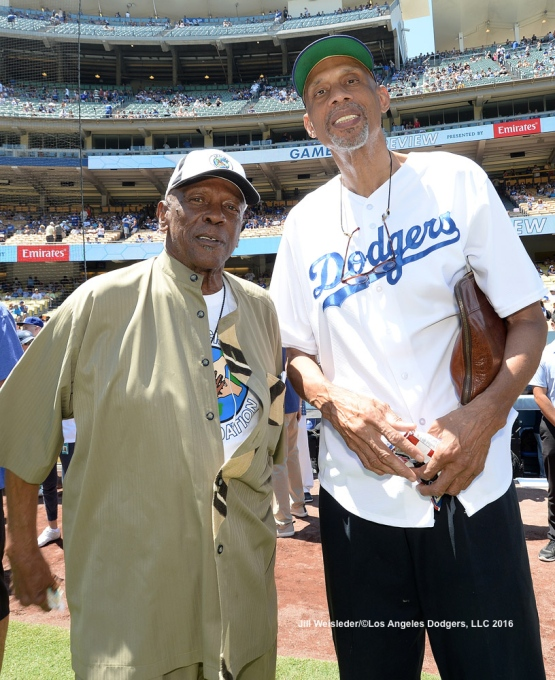 "Actor Louis Gossett Jr. and Kareem Abdul-Jabbar were on hand to help celebrate Earvin ""Magic"" Johnson's birthday prior to the start of the game. Jill Weisleder/Dodgers"