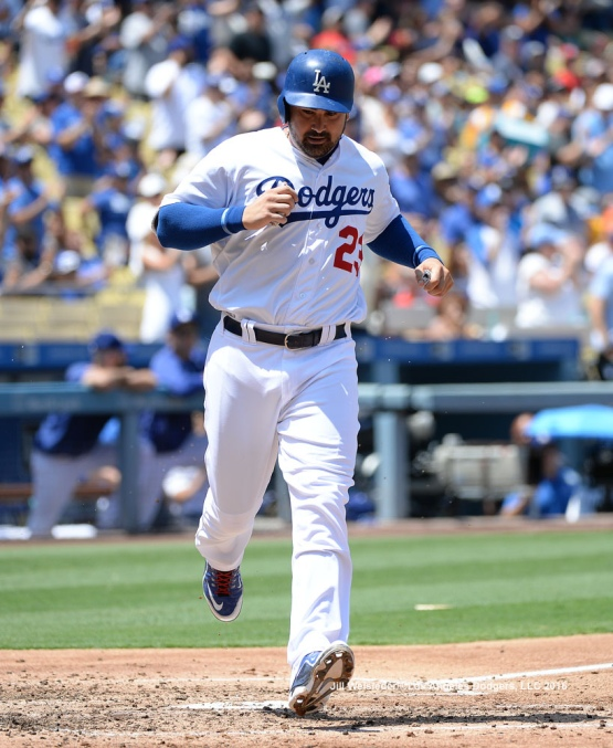 Adrian Gonzalez scores in a run on A.J. Ellis' single to left field. Jill Weisleder/Dodgers