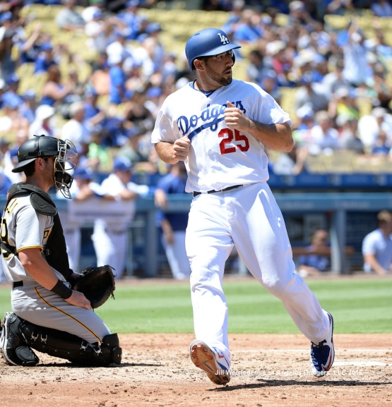 Rob Segedin crosses the plate and scores in a run. Jill Weisleder/Dodgers