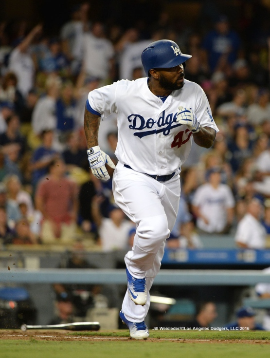 Howie Kendrick watches his ball take flight as he gets a home run in the second inning. Jill Weisleder/Dodgers