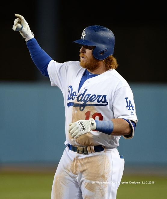 Justin Turner points to the dugout as he gets a single. Jill Weisleder/Dodgers