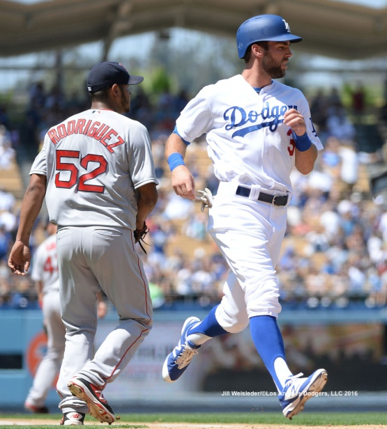 Chris Taylor crosses home plate to score in a run. Jill Weisleder/Dodgers