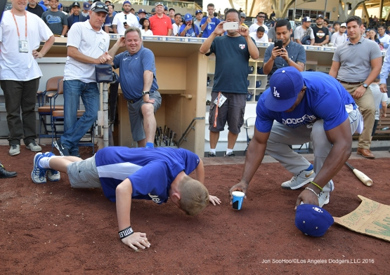 Great Los Angeles Dodger fan does pushups for bat of Yasiel Puig at the San Diego Padres Thursday, September 29, 2016 at Petco Park. Photo by Jon SooHoo/©Los Angeles Dodgers,LLC 2016