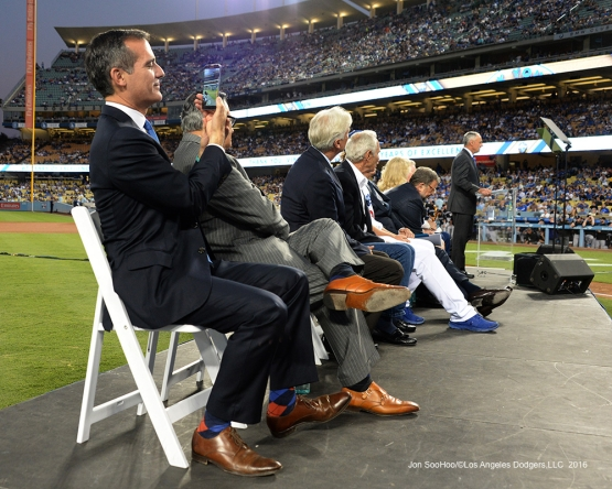 LA Mayor Eric Garcetti works the phone during Vin Scully Ceremony Friday, September 23, 2016 at Dodger Stadium. Photo by Jon SooHoo/©Los Angeles Dodgers,LLC 2016