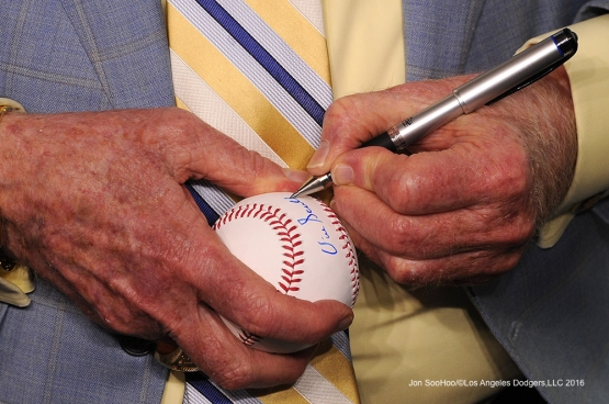 Vin Scully signs a ball prior to Los Angeles Dodgers game against the San Diego Padres Sunday, September 4, 2016 at Dodger Stadium. Photo by Jon SooHoo/©Los Angeles Dodgers,LLC 2016