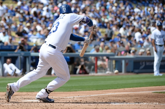 Los Angeles Dodgers Adrian Gonzalez bunts a single against the San Diego Padres Sunday, September 4, 2016 at Dodger Stadium. Photo by Jon SooHoo/©Los Angeles Dodgers,LLC 2016