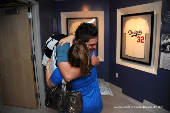 Jose DeLŽon hugs his mom after his first win after defeating the San Diego Padres Sunday, September 4, 2016 at Dodger Stadium. Photo by Jon SooHoo/©Los Angeles Dodgers,LLC 2016