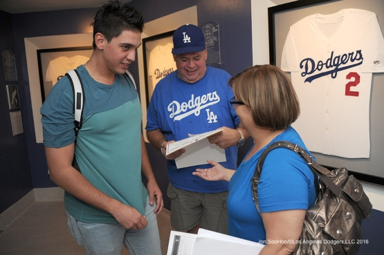 Jose DeLŽon with his mom and dad after his first win after defeating the San Diego Padres Sunday, September 4, 2016 at Dodger Stadium. Photo by Jon SooHoo/©Los Angeles Dodgers,LLC 2016