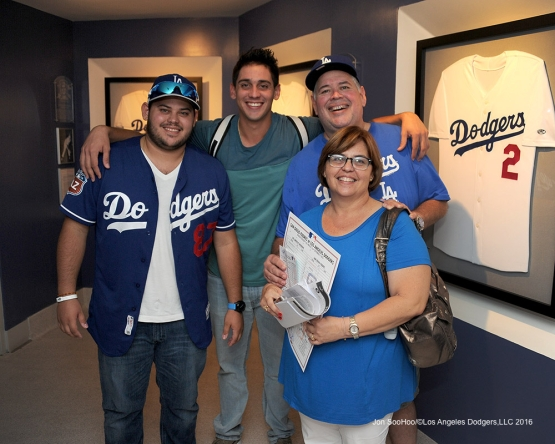 Jose DeLŽon with his family after his first win after defeating the San Diego Padres Sunday, September 4, 2016 at Dodger Stadium. Photo by Jon SooHoo/©Los Angeles Dodgers,LLC 2016