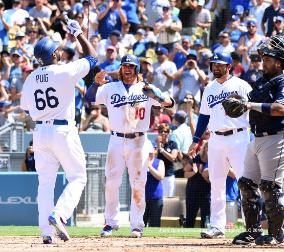 Yasiel Puig is greeted at home by Justin Turner and Adrian Gonzalez after hitting a three-run homer in the third inning. LOS ANGELES - AUGUST 23:  San Francisco Giants against the Los Angeles Dodgers on August 24, 2016 at Dodger Stadium in Los Angeles, California. LOS ANGELES - AUGUST 23:  San Francisco Giants against the Los Angeles Dodgers on August 24, 2016 at Dodger Stadium in Los Angeles, California. LOS ANGELES - AUGUST 23:  San Francisco Giants against the Los Angeles Dodgers on August 24, 2016 at Dodger Stadium in Los Angeles, California. LOS ANGELES - AUGUST 23:  San Francisco Giants against the Los Angeles Dodgers on August 24, 2016 at Dodger Stadium in Los Angeles, California. LOS ANGELES - AUGUST 24:  San Francisco Giants against the Los Angeles Dodgers on August 24, 2016 at Dodger Stadium in Los Angeles, California. LOS ANGELES - AUGUST 24:  San Francisco Giants against the Los Angeles Dodgers on August 24, 2016 at Dodger Stadium in Los Angeles, California. LOS ANGELES - AUGUST 23:  San Francisco Giants against the Los Angeles Dodgers on August 24, 2016 at Dodger Stadium in Los Angeles, California. LOS ANGELES - AUGUST 23:  San Francisco Giants against the Los Angeles Dodgers on August 24, 2016 at Dodger Stadium in Los Angeles, California. LOS ANGELES - AUGUST 23:  San Francisco Giants against the Los Angeles Dodgers on August 24, 2016 at Dodger Stadium in Los Angeles, California. LOS ANGELES - AUGUST 23:  San Francisco Giants against the Los Angeles Dodgers on August 24, 2016 at Dodger Stadium in Los Angeles, California. LOS ANGELES - AUGUST 24:  San Francisco Giants against the Los Angeles Dodgers on August 24, 2016 at Dodger Stadium in Los Angeles, California. LOS ANGELES - AUGUST 23:  San Francisco Giants against the Los Angeles Dodgers on August 24, 2016 at Dodger Stadium in Los Angeles, California. LOS ANGELES - AUGUST 23:  San Francisco Giants against the Los Angeles Dodgers on August 24, 2016 at Dodger Stadium in Los Angeles, California. LOS ANGELES - AUGUST 23:  San Francisco Giants against the Los Angeles Dodgers on August 24, 2016 at Dodger Stadium in Los Angeles, California. LOS ANGELES - AUGUST 23:  San Francisco Giants against the Los Angeles Dodgers on August 24, 2016 at Dodger Stadium in Los Angeles, California. LOS ANGELES - AUGUST 24:  San Francisco Giants against the Los Angeles Dodgers on August 24, 2016 at Dodger Stadium in Los Angeles, California. LOS ANGELES - AUGUST 23:  San Francisco Giants against the Los Angeles Dodgers on August 24, 2016 at Dodger Stadium in Los Angeles, California. LOS ANGELES - AUGUST 23:  San Francisco Giants against the Los Angeles Dodgers on August 24, 2016 at Dodger Stadium in Los Angeles, California. LOS ANGELES - AUGUST 23:  San Francisco Giants against the Los Angeles Dodgers on August 24, 2016 at Dodger Stadium in Los Angeles, California. LOS ANGELES - AUGUST 23:  San Francisco Giants against the Los Angeles Dodgers on August 24, 2016 at Dodger Stadium in Los Angeles, California. LOS ANGELES - AUGUST 23:  San Francisco Giants against the Los Angeles Dodgers on August 24, 2016 at Dodger Stadium in Los Angeles, California. LOS ANGELES - AUGUST 23:  San Francisco Giants against the Los Angeles Dodgers on August 24, 2016 at Dodger Stadium in Los Angeles, California. LOS ANGELES - AUGUST 23:  San Francisco Giants against the Los Angeles Dodgers on August 24, 2016 at Dodger Stadium in Los Angeles, California. LOS ANGELES - AUGUST 23:  San Francisco Giants against the Los Angeles Dodgers on August 24, 2016 at Dodger Stadium in Los Angeles, California. LOS ANGELES - AUGUST 24:  San Francisco Giants against the Los Angeles Dodgers on August 24, 2016 at Dodger Stadium in Los Angeles, California. LOS ANGELES - AUGUST 23:  San Francisco Giants against the Los Angeles Dodgers on August 24, 2016 at Dodger Stadium in Los Angeles, California. LOS ANGELES - AUGUST 23:  San Francisco Giants against the Los Angeles Dodgers on August 24, 2016 at Dodger Stadium in Los Angeles, California. LOS ANGELES - AUGUST 23:  San Francisco Giants against the Los Angeles Dodgers on August 24, 2016 at Dodger Stadium in Los Angeles, California. LOS ANGELES - AUGUST 23:  San Francisco Giants against the Los Angeles Dodgers on August 24, 2016 at Dodger Stadium in Los Angeles, California. LOS ANGELES - AUGUST 23:  San Francisco Giants against the Los Angeles Dodgers on August 24, 2016 at Dodger Stadium in Los Angeles, California. LOS ANGELES - SEPTEMBER 1:  Los Angeles Dodgers Bark In The Park event on September 1, 2012 at Dodger Stadium in Los Angeles, California.LOS ANGELES - AUGUST 24:  San Francisco Giants against the Los Angeles Dodgers on August 24, 2016 at Dodger Stadium in Los Angeles, California. LOS ANGELES - AUGUST 24:  San Francisco Giants against the Los Angeles Dodgers on August 24, 2016 at Dodger Stadium in Los Angeles, California. LOS ANGELES - AUGUST 23:  San Francisco Giants against the Los Angeles Dodgers on August 24, 2016 at Dodger Stadium in Los Angeles, California. LOS ANGELES - AUGUST 23:  San Francisco Giants against the Los Angeles Dodgers on August 24, 2016 at Dodger Stadium in Los Angeles, California. LOS ANGELES - AUGUST 23:  San Francisco Giants against the Los Angeles Dodgers on August 24, 2016 at Dodger Stadium in Los Angeles, California. LOS ANGELES - AUGUST 23:  San Francisco Giants against the Los Angeles Dodgers on August 24, 2016 at Dodger Stadium in Los Angeles, California. LOS ANGELES - AUGUST 24:  San Francisco Giants against the Los Angeles Dodgers on August 24, 2016 at Dodger Stadium in Los Angeles, California. LOS ANGELES - AUGUST 23:  San Francisco Giants against the Los Angeles Dodgers on August 24, 2016 at Dodger Stadium in Los Angeles, California. LOS ANGELES - AUGUST 23:  San Francisco Giants against the Los Angeles Dodgers on August 24, 2016 at Dodger Stadium in Los Angeles, California. LOS ANGELES - AUGUST 23:  San Francisco Giants against the Los Angeles Dodgers on August 24, 2016 at Dodger Stadium in Los Angeles, California. LOS ANGELES - AUGUST 23:  San Francisco Giants against the Los Angeles Dodgers on August 24, 2016 at Dodger Stadium in Los Angeles, California. LOS ANGELES - AUGUST 24:  San Francisco Giants against the Los Angeles Dodgers on August 24, 2016 at Dodger Stadium in Los Angeles, California. LOS ANGELES - AUGUST 23:  San Francisco Giants against the Los Angeles Dodgers on August 24, 2016 at Dodger Stadium in Los Angeles, California. LOS ANGELES - AUGUST 23:  San Francisco Giants against the Los Angeles Dodgers on August 24, 2016 at Dodger Stadium in Los Angeles, California. LOS ANGELES - AUGUST 23:  San Francisco Giants against the Los Angeles Dodgers on August 24, 2016 at Dodger Stadium in Los Angeles, California. LOS ANGELES - AUGUST 23:  San Francisco Giants against the Los Angeles Dodgers on August 24, 2016 at Dodger Stadium in Los Angeles, California. LOS ANGELES - AUGUST 24:  San Francisco Giants against the Los Angeles Dodgers on August 24, 2016 at Dodger Stadium in Los Angeles, California. LOS ANGELES - AUGUST 23:  San Francisco Giants against the Los Angeles Dodgers on August 24, 2016 at Dodger Stadium in Los Angeles, California. LOS ANGELES - AUGUST 23:  San Francisco Giants against the Los Angeles Dodgers on August 24, 2016 at Dodger Stadium in Los Angeles, California. LOS ANGELES - AUGUST 23:  San Francisco Giants against the Los Angeles Dodgers on August 24, 2016 at Dodger Stadium in Los Angeles, California. LOS ANGELES - AUGUST 23:  San Francisco Giants against the Los Angeles Dodgers on August 24, 2016 at Dodger Stadium in Los Angeles, California. LOS ANGELES - AUGUST 23:  San Francisco Giants against the Los Angeles Dodgers on August 24, 2016 at Dodger Stadium in Los Angeles, California. LOS ANGELES - AUGUST 24:  San Francisco Giants against the Los Angeles Dodgers on August 24, 2016 at Dodger Stadium in Los Angeles, California. LOS ANGELES - AUGUST 23:  San Francisco Giants against the Los Angeles Dodgers on August 24, 2016 at Dodger Stadium in Los Angeles, California. LOS ANGELES - AUGUST 23:  San Francisco Giants against the Los Angeles Dodgers on August 24, 2016 at Dodger Stadium in Los Angeles, California. LOS ANGELES - AUGUST 23:  San Francisco Giants against the Los Angeles Dodgers on August 24, 2016 at Dodger Stadium in Los Angeles, California. LOS ANGELES - AUGUST 23:  San Francisco Giants against the Los Angeles Dodgers on August 24, 2016 at Dodger Stadium in Los Angeles, California. LOS ANGELES - AUGUST 23:  San Francisco Giants against the Los Angeles Dodgers on August 24, 2016 at Dodger Stadium in Los Angeles, California.
