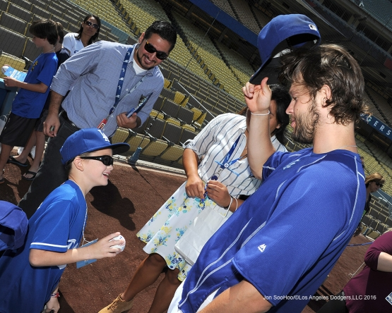 Clayton Kershaw meets Mason Smith prior to  game against the Arizona Diamondbacks Monday, September 5, 2016 at Dodger Stadium. Photo by Jon SooHoo/©Los Angeles Dodgers,LLC 2016