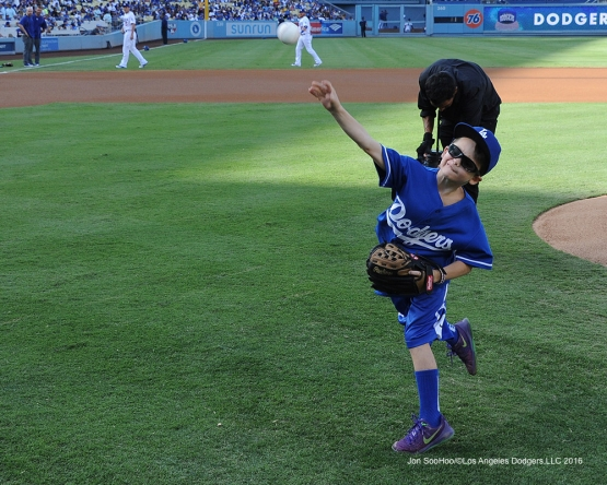 Mason Smith throws out the first pitch prior to  game against the Arizona Diamondbacks Monday, September 5, 2016 at Dodger Stadium. Photo by Jon SooHoo/©Los Angeles Dodgers,LLC 2016