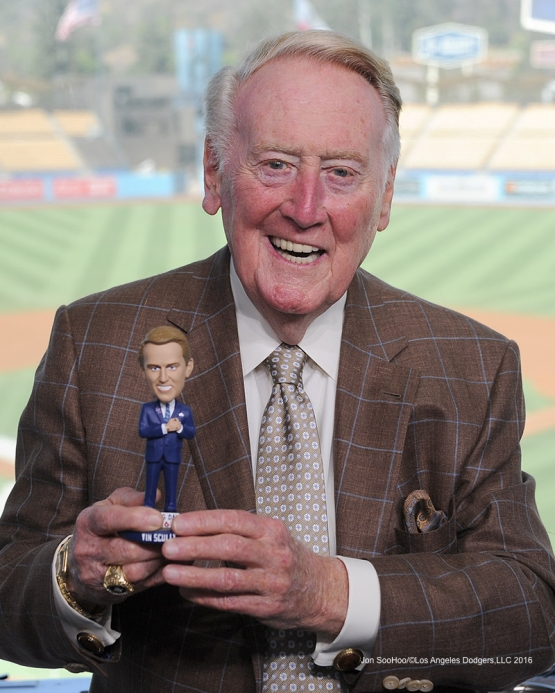 Vin Scully poses with his bobblehead of 2016 prior to  game against the Arizona Diamondbacks Tuesday, September 6, 2016 at Dodger Stadium. Photo by Jon SooHoo/©Los Angeles Dodgers,LLC 2016